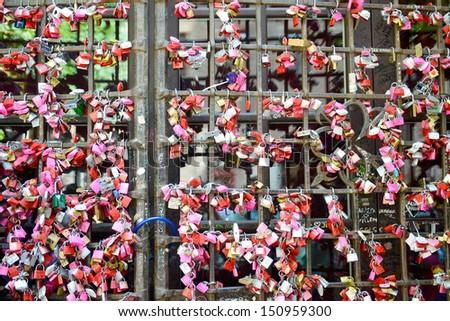Love locks on a bridge - stock photo