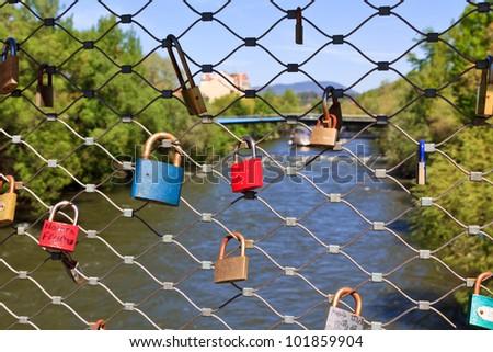 Love locks on a bridge - a widespread habit of putting locks on public bridges - this time in Graz, Austria - stock photo