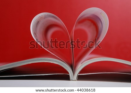 love magazine with red background - stock photo