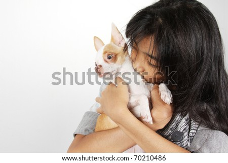 Love me love my dog, A girl hugs and kiss a dog - stock photo