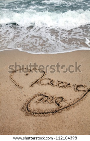 Love message written on beach