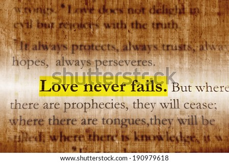 Love never fails. 1Corinthians 13:8, Holy bible.  - stock photo
