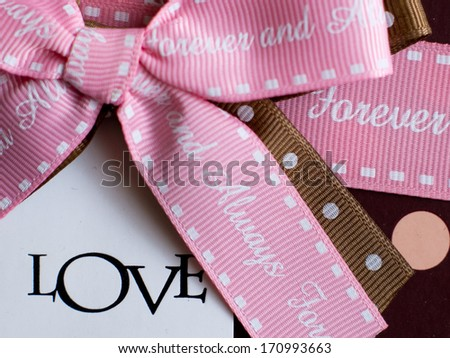 Love note with the color ribbon on the color paper