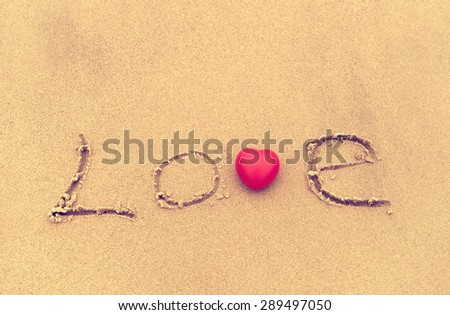 love on the sand texture background - stock photo