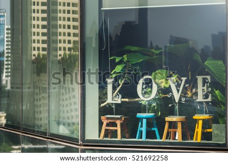 Love on window with chair.