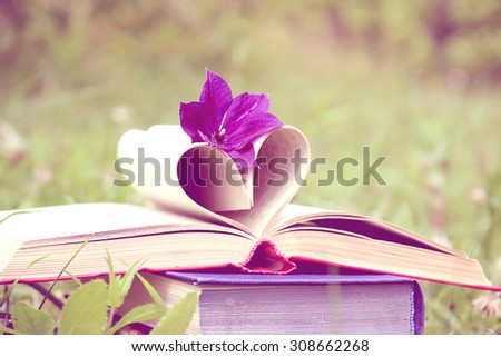 Love. Open book.  Knowledge is power. Education. Enlightenment. Love in nature - stock photo