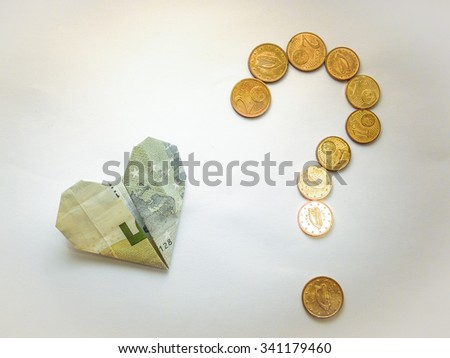 Love or money? Heart shaped five euro banknote and a question mark sign made out of coins. - stock photo