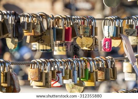 Love padlocks on Butcher's bridge in Ljubljana, Slovenia - stock photo