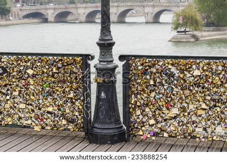 Love padlocks on Pont des Arts bridge, Seine river - Paris. France, Europe. - stock photo