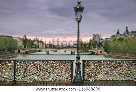 Love padlocks on the bridge Pont des Arts across river Seine in Paris, France. - stock photo