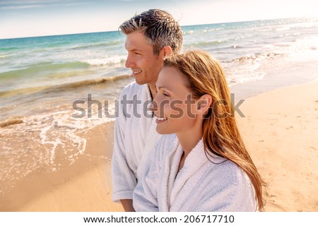 love paradise smiling while walking down sundown  - stock photo