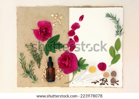Love potion ingredients over natural hemp notebook and mottled cream paper background. - stock photo