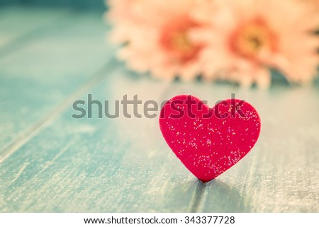 Love red heart on blue wooden table background - stock photo
