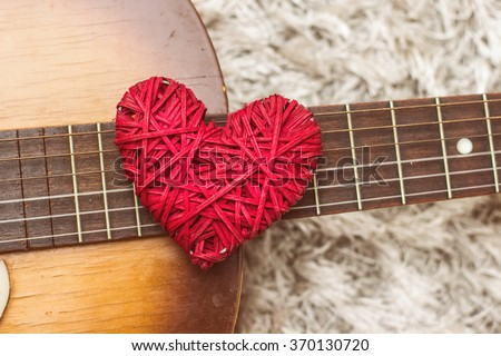 Love Red Heart on the guitar , romance and music, Valentine day - stock photo