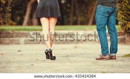 Love romance relationship dating concept. Couple in park taking walk. Girlfriend and boyfriend spending time together.