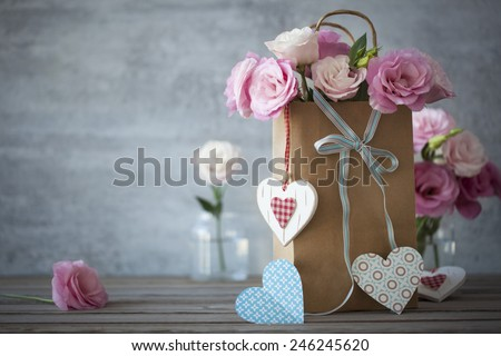 Love's still life background with pink roses, ribbons and handcrafted hearts - stock photo