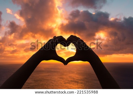 Love shape hand silhouette - stock photo