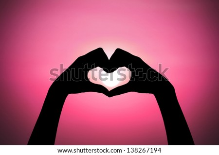 love shape hand silhouette at sunset - stock photo