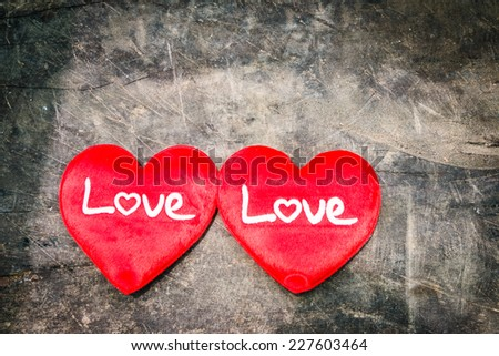 Love sign on wood background, valentine day. - stock photo