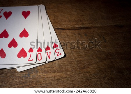 LOVE spelled out on a set of playing cards - stock photo