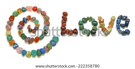 Love Spiral Crystals  -   A Spiral and the word 'LOVE' formed from tumbled precious stones on a white background - stock photo