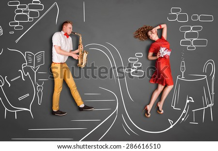 Love story concept of a romantic couple against chalk drawings background. Male playing the sax in a restaurant for his girlfriend. - stock photo