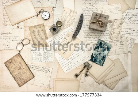 love story. old letters, vintage postcards and antique feather pen. nostalgic sentimental background with retro picture of couple - stock photo