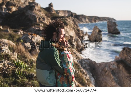 Love story on Tarhankut coast in Crimea. Young couple in love at sunset