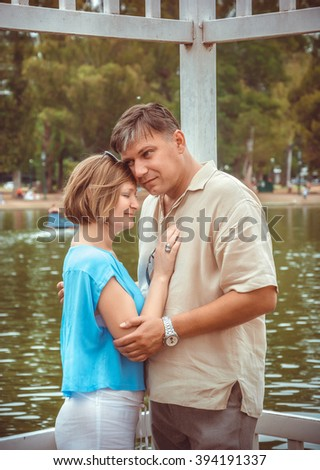 Love story. Young couple in the summer park
