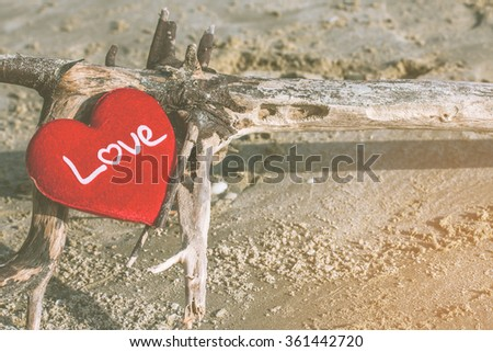 love summer decorate with heart on sand beach over  blue sea with filter colored.