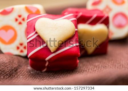 Love sweet heart shaped chocolates candies - stock photo