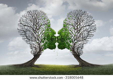 Love Therapy and relationship recovery counseling concept as two empty trees shaped as a human head attracted together as a devoted loving couple with kissing lips for a healthy passionate relation. - stock photo