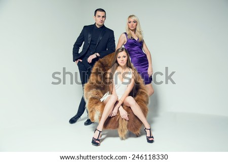 Love triangle. Man and two women blonde and brunette. Love, sexy - modern concept of love story for three people. The love story between a man and two women. Love or jealousy, lover or wife. - stock photo
