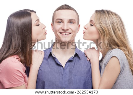 Love triangle. Two young women kissing to the man. isolated on white background. - stock photo