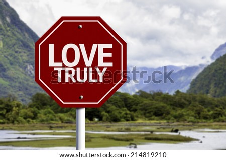 Love Truly red sign with a landscape background