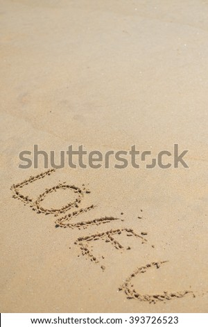 LOVE U sign on wet sand beach background closeup picture