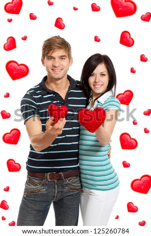 love valentine day couple holding red heart, happy smile looking at camera together, hug, isolated over white background, concept hearts flying around - stock photo