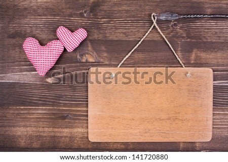 Love Valentine hearts, signboard hanging on vintage wood background - stock photo