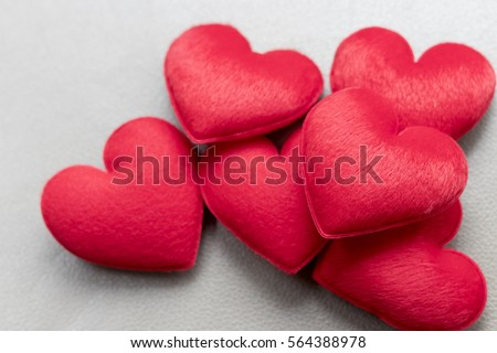 Love valentine's hearts on gray genuine leather (with pattern on surface) background. With copy space. Celebration concept.