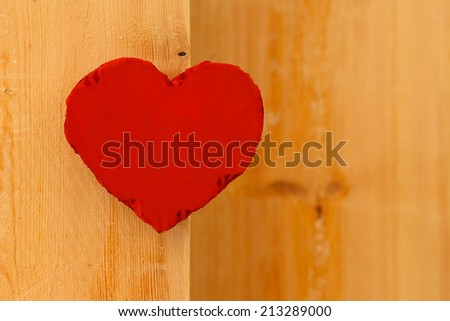 Love Valentines red painted recycled cardboard heart on rough sawn pine boards background, copy space - stock photo