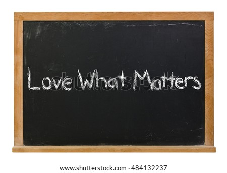 Love what matters written in white chalk on a black chalkboard isolated on white