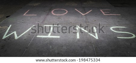 Love wins chalked on the steps of a court house - stock photo
