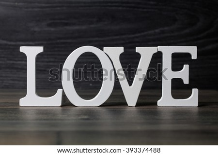 Love wooden text on vintage board background with copy space
