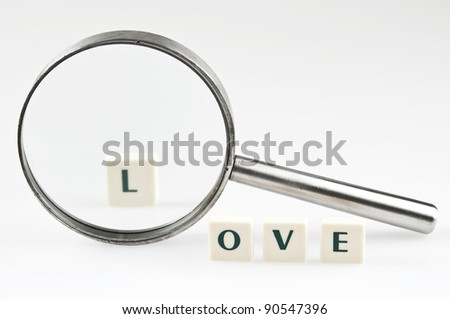 Love word and magnifying glass - stock photo