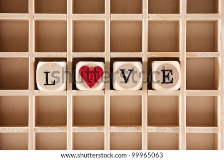 love word construction with letter blocks / cubes, a heart and a shallow depth of field