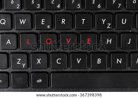 Love word highlighted on keyboard of laptop. Conception of internet dating.