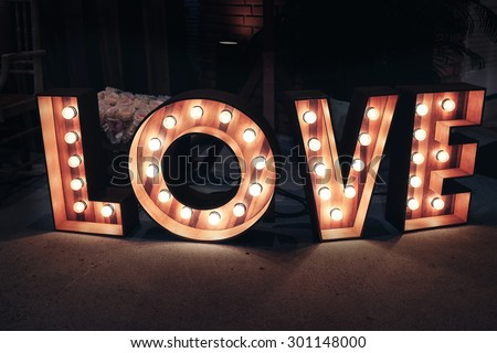 Love word with glowing light bulbs