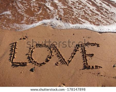 Love words on the beach - stock photo