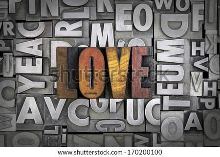 Love written in vintage letterpress type - stock photo