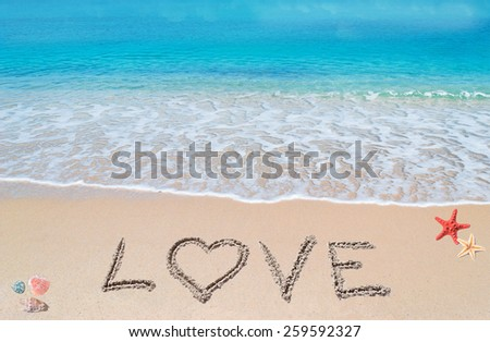 love written on a tropical beach